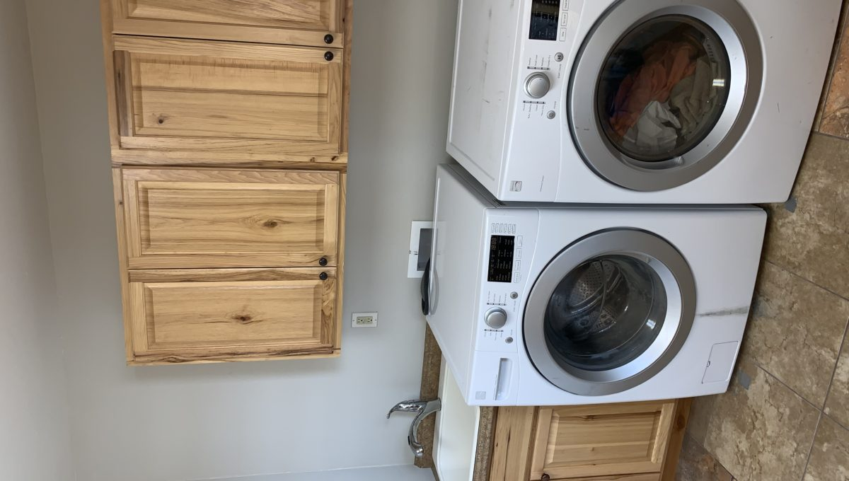 Spacious Laundry Room and Cabinets
